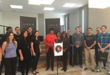 """D.C. Mayor Muriel Bowser speaks at Uber's new East Coast headquarters on Nov. 6 in Northwest during a kickoff event for the city's """"Scissors and Shovels Day."""" (Courtesy of the mayor's office via Twitter)"""