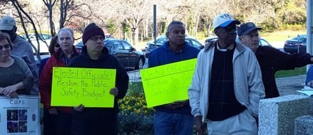 Prince George's County residents hold a rally in front of the County Administration building in Upper Marlboro on Nov. 16 in support of police officers. PHOTO BY WILLIAM J. FORD