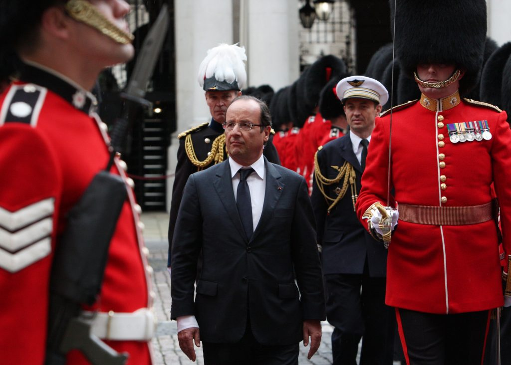 "President François Hollande called the attacks in Paris on Friday ""an act of war."" Photo of French President François Hollande during an inspection of the Guard of Honour at the Foreign Office in London, 10 July 2012. (Wikimedia Commons)"