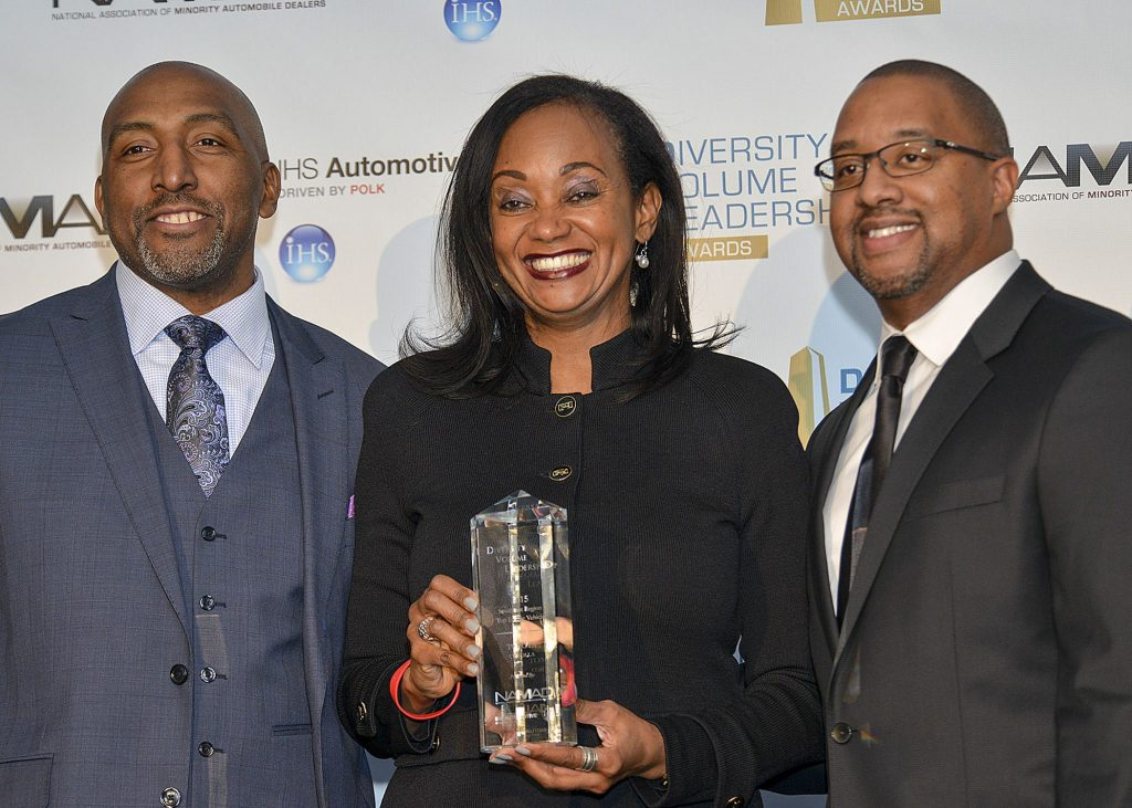 Alva Adams-Mason, the director of African American Business Strategy and Corporate Communications of Toyota North America (center) accepts a Diversity Volume Leadership Award for the Toyota team from Marc Bland, the vice president of diversity and inclusion for IHS Automotive (left) and Damon Lester, the president of NAMAD at the Diversity Volume Leadership Awards in Detroit, Mich. (Freddie Allen/AMG/NNPA)