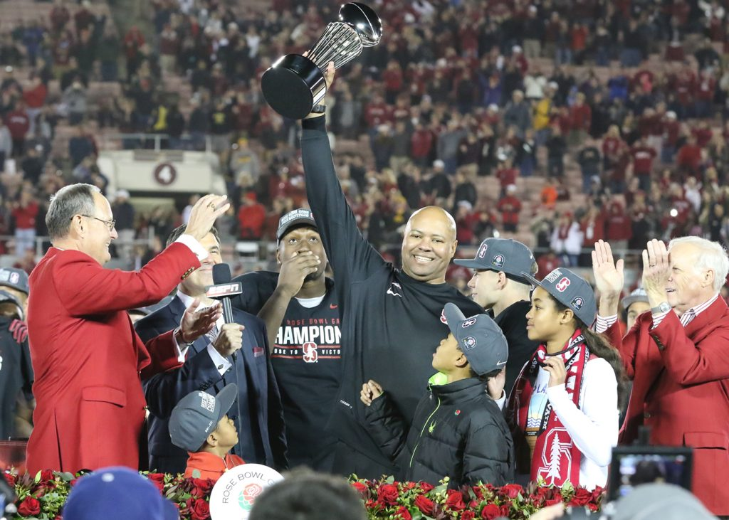 Stanford Cardinal head coach David Shaw raises the Championship trophy at the 102nd Rose Bowl game between the Stanford Cardinal and the Iowa Hawkeyes, January 1, 2016. (Jevone Moore/FI360 News)
