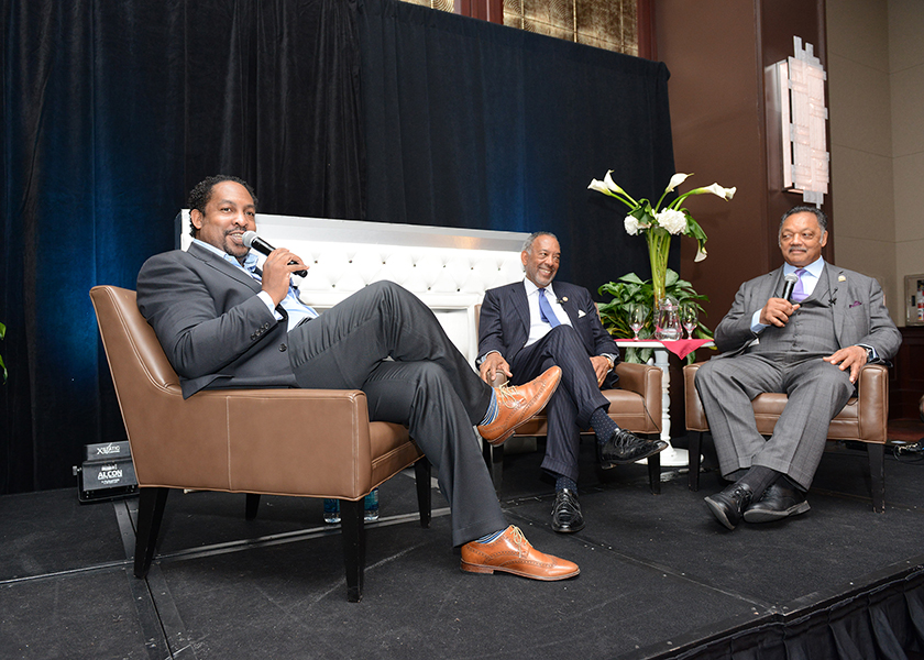 "From left to right: Journalist Navarrow Wright, John Thompson of Microsoft and Rev. Jesse Jackson, Sr. speak during a ""fireside chat"" at the Wall Street Project Economic Summit in New York City. (Margot Jordan/RPC)"