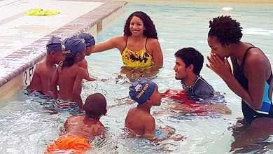 Photo of Black Olympians Promote Urban Youth Swimming