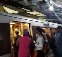 Metrorail passengers board an Orange Line train at the L'Enfant Plaza station in southwest D.C. on June 6. PHOTO BY WILLIAM J. FORD
