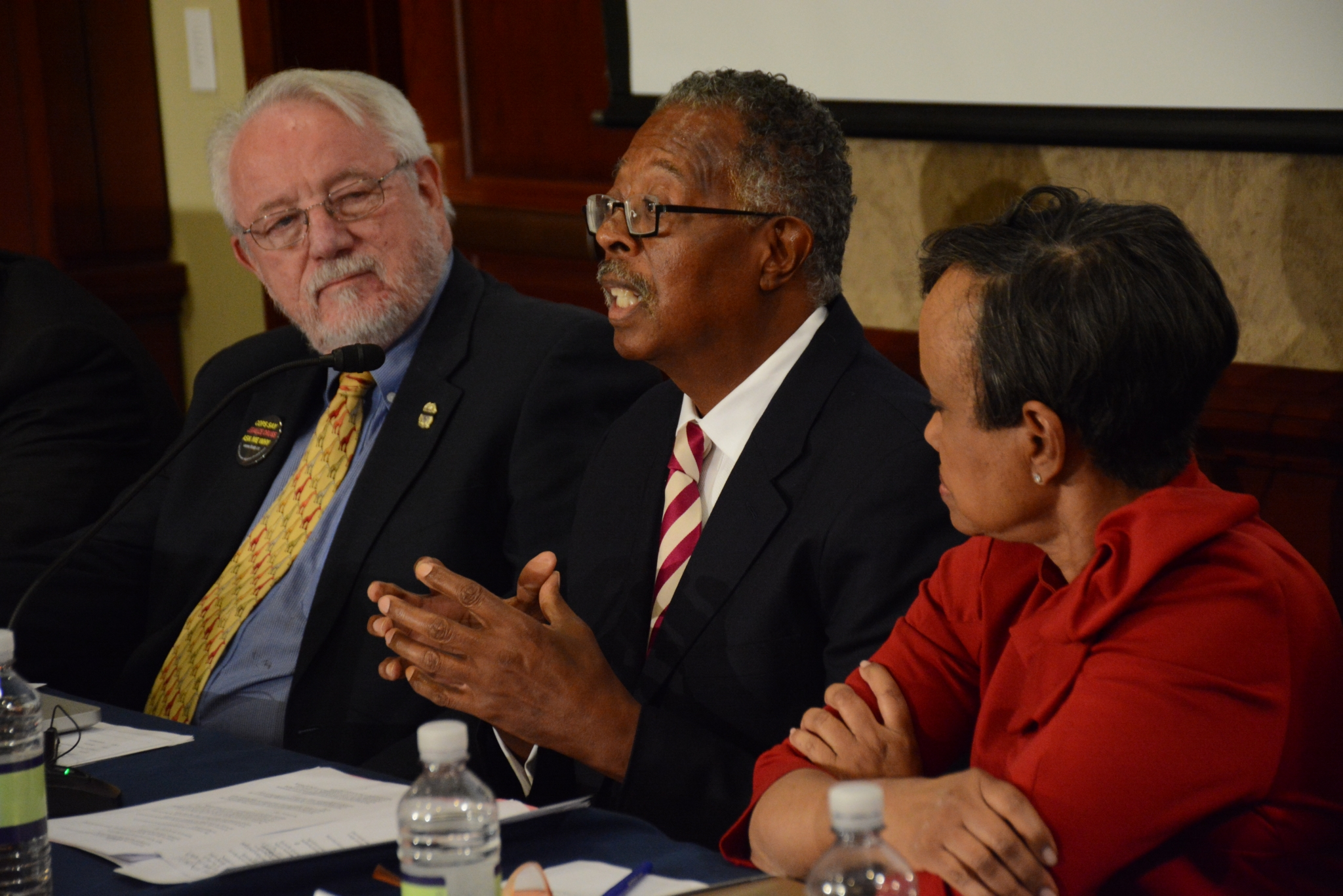 Dr. George W. Woods, Jr. speaks on the Gun Violence and Trauma Congressional Briefing panel held Monday, Nov. 1 in Northwest with Jack Cole (left), co-founder of Law Enforcement Against Prohibition, and Judge Glenda Hatchet. /Photo by Roy Lewis