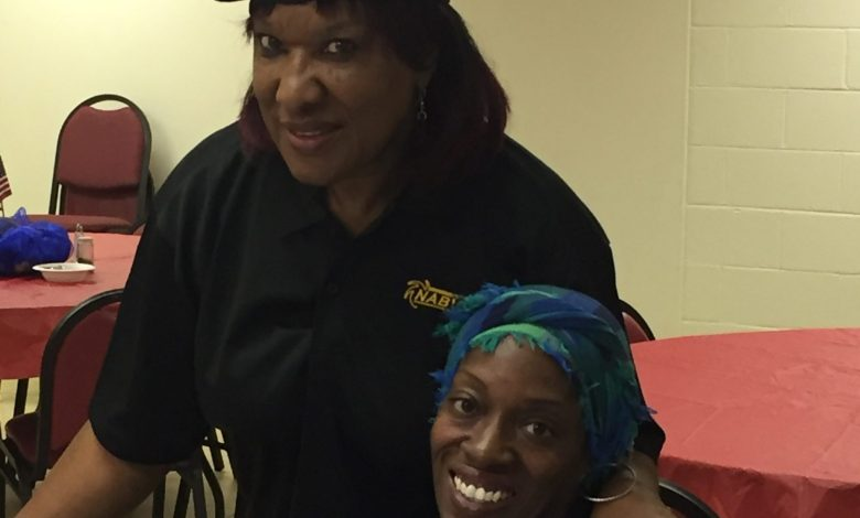 Georgia Eaves, commander of the D.C. chapter of the National Association of Black American Veterans, greets Antoinette Scott, a former member of the D.C. National Guard who received a Purple Heart, during a prayer breakfast at the Springfield Baptist Church in Northwest on Nov. 6.