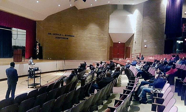 Several dozen people attend Prince George's County Public Schools' town hall on social media at Eleanor Roosevelt High School in Greenbelt on Nov. 10. /Photo by William J. Ford