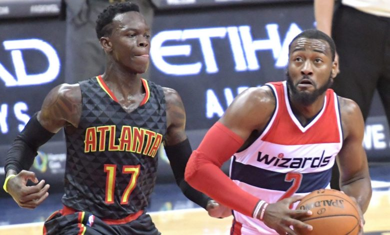 Washington Wizards point guard John Wall penetrates the lane against Atlanta Hawks point guard Dennis Schroder during the Wizards' 95-92 win at Verizon Center in northwest D.C. on Friday, Nov. 4 PHOTO BY WILLIAM J. FORD