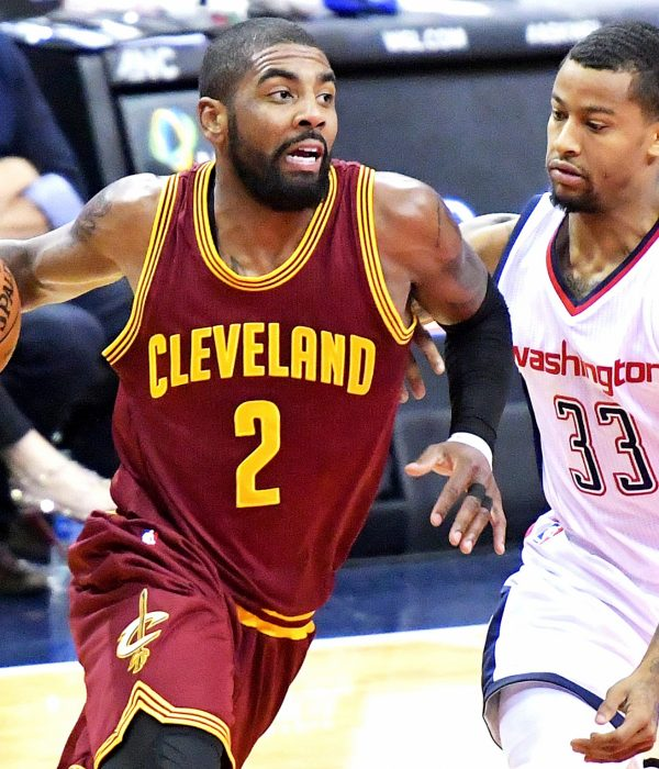 Cleveland Cavaliers point guard Kyrie Irving drives past Washington Wizards point guard Trey Burke during the Cavaliers' 105-94 win at Verizon Center in Northwest on Friday, Nov. 11. /Photo by John E. De Freitas