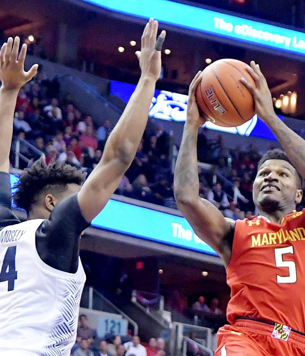 Maryland Terrapins guard Dion Wiley goes to the basket against Georgetown Hoyas guard Jagan Mosely in the first half of Maryland's 76-75 road win at Verizon Center in northwest D.C. on Tuesday, Nov. 15. /Photo by John E. De Freitas