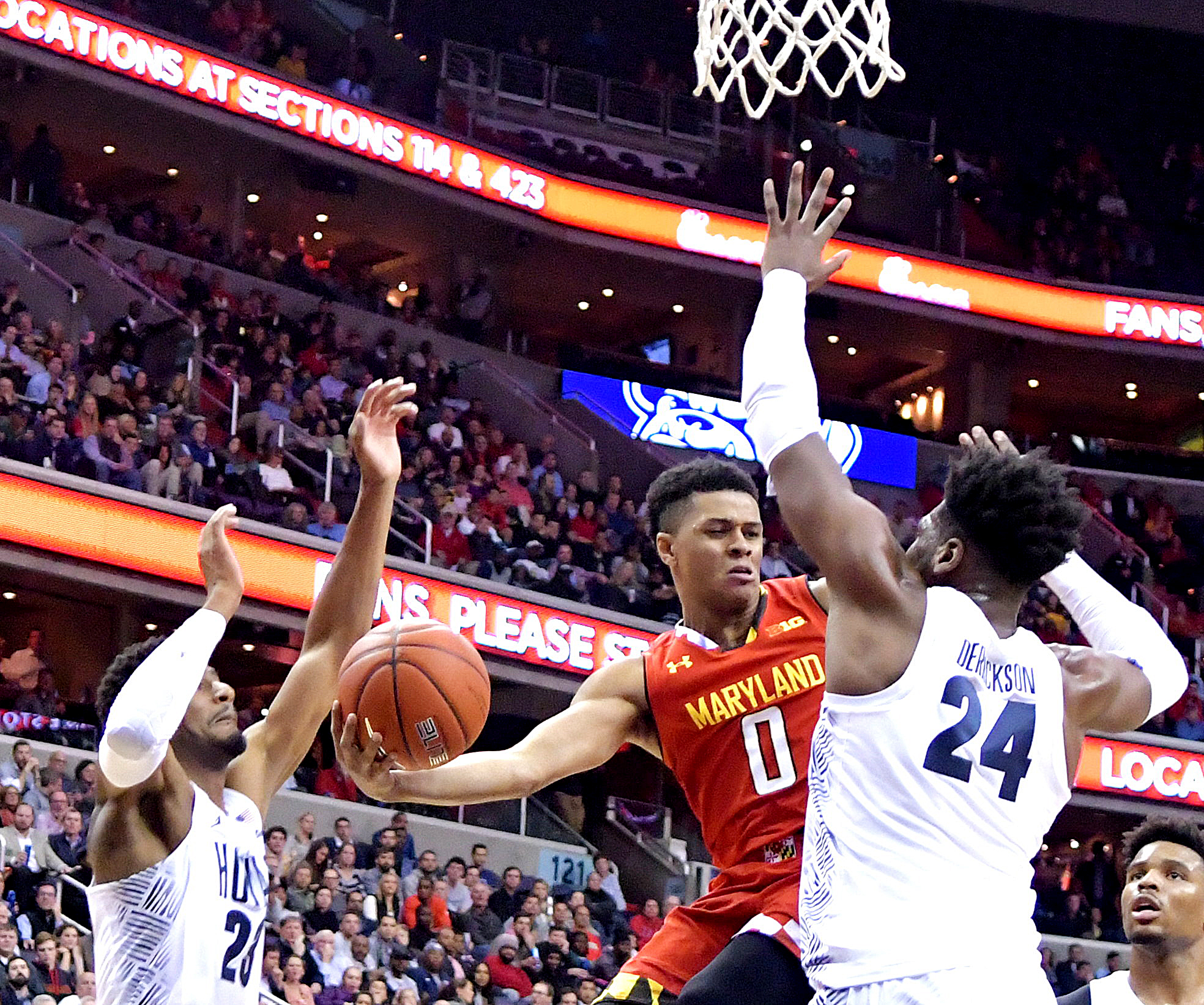 Maryland Terrapins guard Anthony Cowan is defended by Georgetown Hoyas forward Marcus Derrickson during Maryland's 76-75 road win at Verizon Center in northwest D.C. on Tuesday, Nov. 15. /Photo by John E. De Freitas