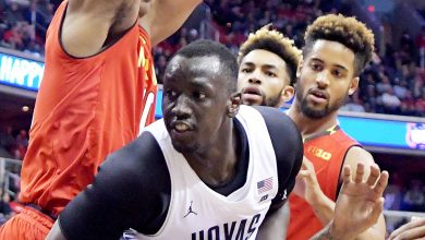 Georgetown Hoyas forward Akoy Agau is smothered by Maryland Terrapins in the second half of Maryland's 76-75 road win at Verizon Center in northwest D.C. on Tuesday, Nov. 15. /Photo by John E. De Freitas