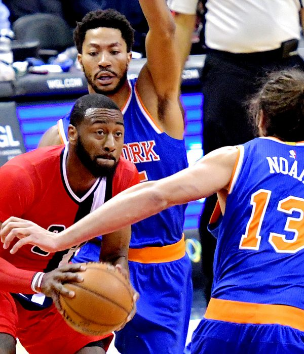 Washington Wizards point guard John Wall is double-teamed by New York Knicks point guard Derrick Rose and center Joakim Noah during the Wizards' 119-112 win at Verizon Center in northwest D.C. on Thursday, Nov. 17. /Photo by John E. De Freitas