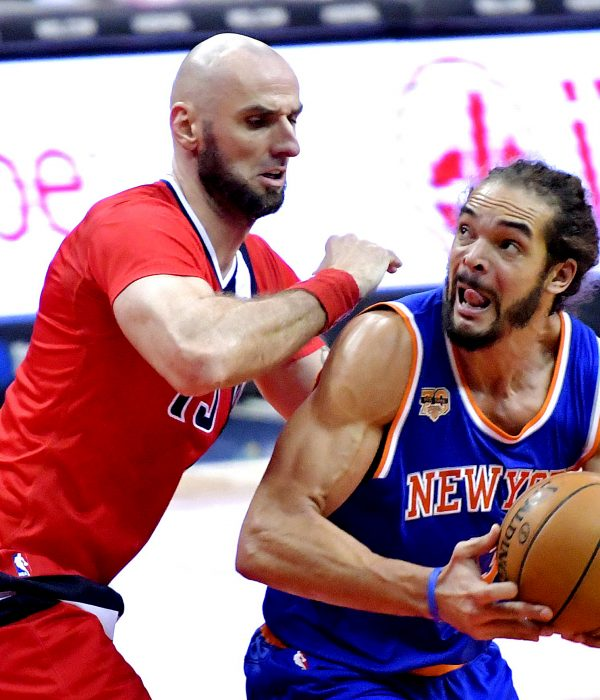 New York Knicks center Joakim Noah is guarded by Washington Wizards center Marcin Gortat in the third quarter of the Wizards' 119-112 win at Verizon Center in northwest D.C. on Thursday, Nov. 17. /Photo by John E. De Freitas