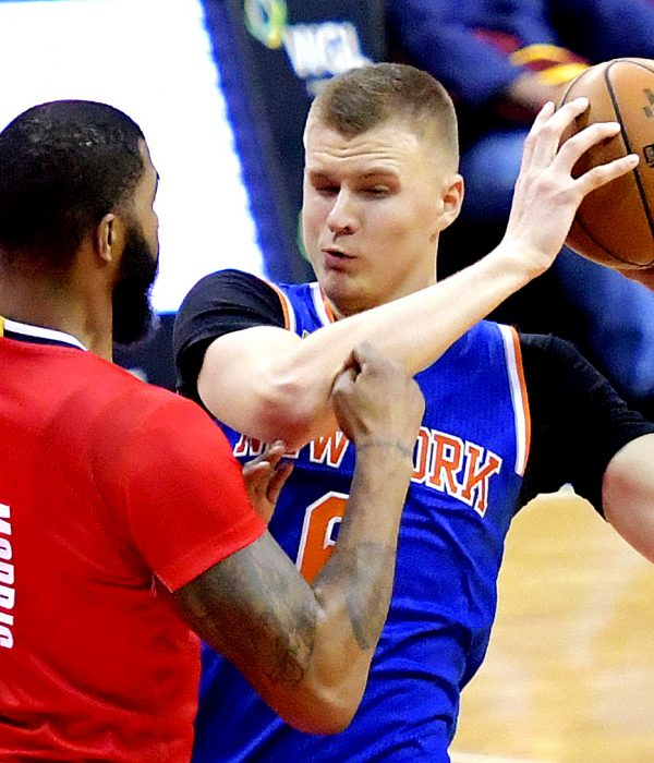 New York Knicks power forward Kristaps Porzingis is guarded by Washington Wizards power forward Markieff Morris in the third quarter of the Wizards' 119-112 win at Verizon Center in northwest D.C. on Thursday, Nov. 17. /Photo by John E. De Freitas