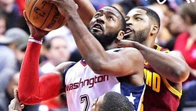 Washington Wizards point guard John Wall drives to the bucket against two Cleveland Cavalier defenders in the first quarter of the Cavaliers' 105-94 victory at Verizon Center on Nov. 11. /Photo by John De Freitas