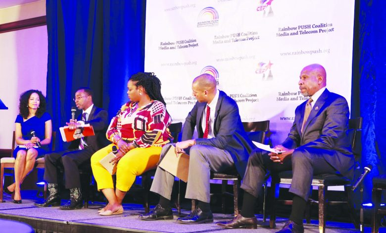 Grainger Browning (right) pastor of Ebenezer AME Church in Ft. Washington, Spencer Overton (second from right), president and CEO of the Joint Center for Political and Economic Studies, and Elroy Sailor (second from left), founder and CEO of J.C. Watts Companies, participate in a panel discussion during the annual Media & Telecom Conference at the Capital Hilton Hotel in Northwest on Tuesday, Dec. 6. /Photo by Demetrious Kinney