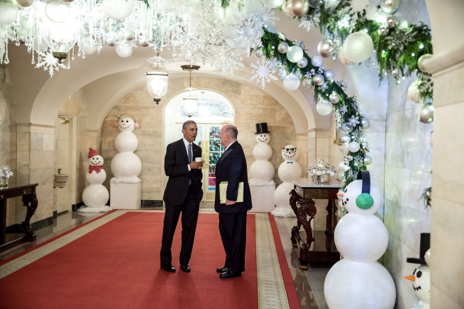 **FILE** President Barack Obama talks with Tom Donilon, chair of the President's Commission on Enhancing National Cybersecurity, in the Lower Cross Hall of the White House on Dec. 2, 2016. (Pete Souza/White House)