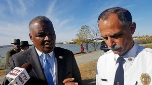 Prince George's County Rushern L. Baker III (left), alongside county fire Chief Marc Bashoor, speaks with reporters on Nov. 22 about the new public-safety pier scheduled for construction next year at National Harbor. /Photo by William J. Ford