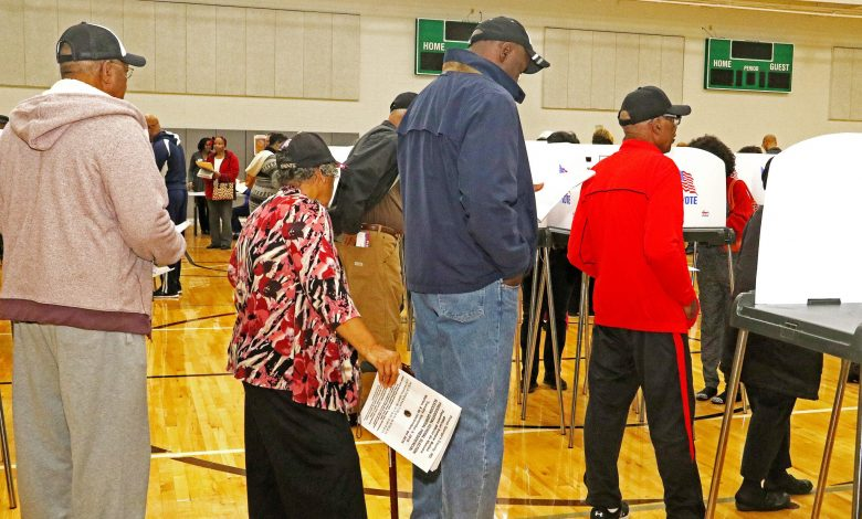 Hundreds of Prince George's County residents file into the gym at the Southern Regional Technology and Recreation Complex in Fort Washington to cast their ballots on Oct. 27, the first day of Maryland's early-voting period. Photo by Shevry Lassiter
