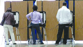 Prince George's County voters use touch-screen machines to cast votes at a precinct at Woodmore Elementary School in Mitchellville, Maryland, during the Nov. 4 general election. William J. Ford