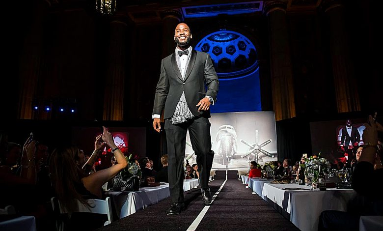 Athletes took to the runway in a fashion show fundraiser for local programs that support and assist victims of domestic violence.
