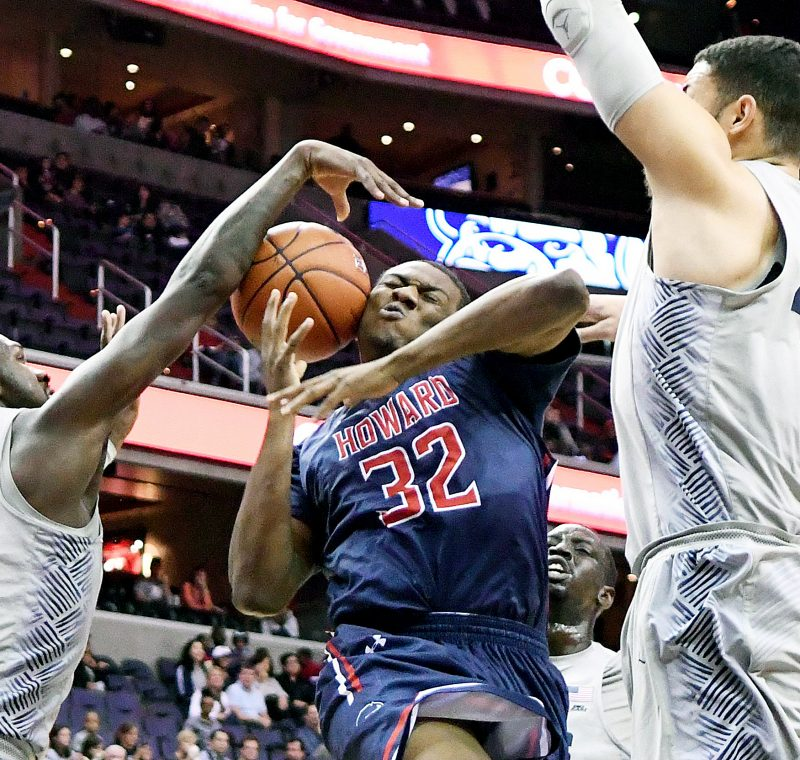 Howard Bison forward Tyler Stone fights through multiple Georgetown Hoyas defenders in the first half of the Hoyas' 85-72 win at Verizon Center in Northwest on Sunday, Nov. 27. /Photo by John E. De Freitas