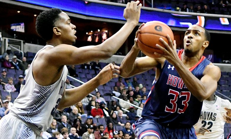 Howard Bison guard James Miller is defended by Georgetown Hoyas guard Kaleb Johnson in the first half of the Hoyas' 85-72 win at Verizon Center in Northwest on Sunday, Nov. 27. /Photo by John E. De Freitas