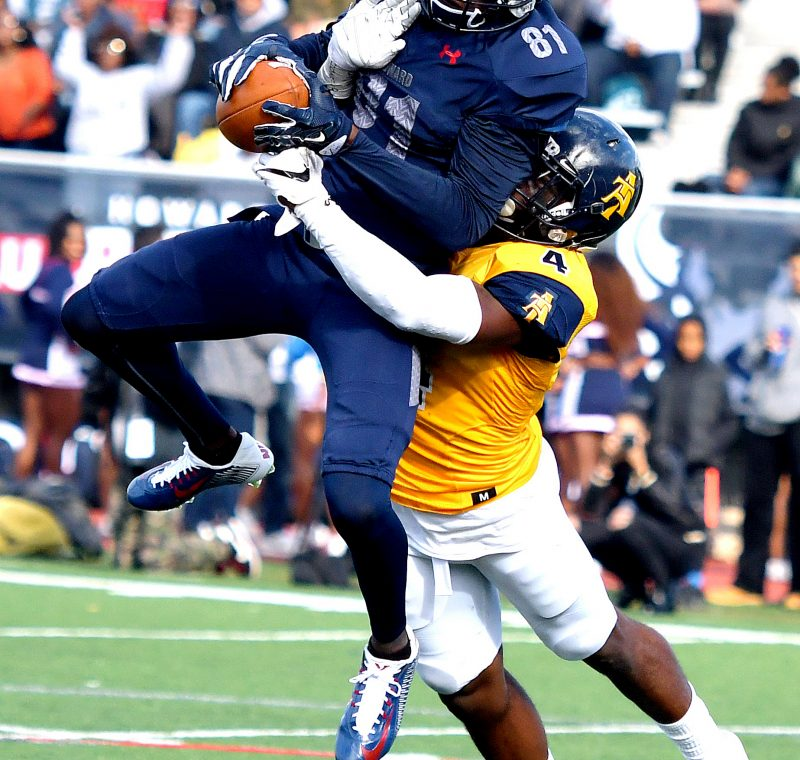 Howard Bison wide receiver Kyle Anthony is tackled by North Carolina A&T linebacker Marcus Albert during the Aggies' 34-7 win in what was Howard's homecoming game on Saturday, Oct. 22 at William H. Greene Stadium in northwest D.C. /Photo by John E. De Freitas