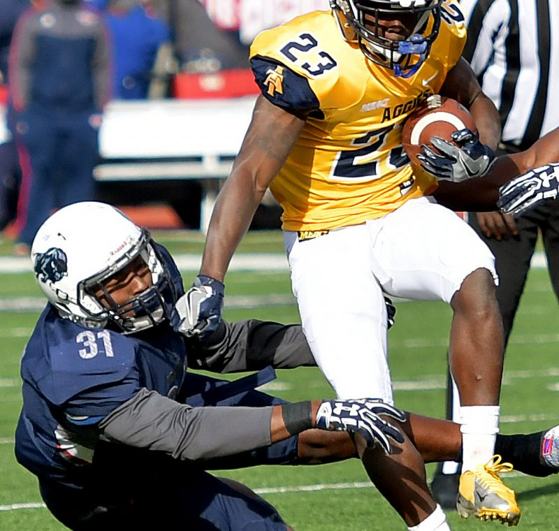 North Carolina A&T running back Amos Williams breaks free from Howard Bison linebacker David Lee for a touchdown run during the Aggies' 34-7 win in what was Howard's homecoming game on Saturday, Oct. 22 at William H. Greene Stadium in northwest D.C. /Photo by John E. De Freitas