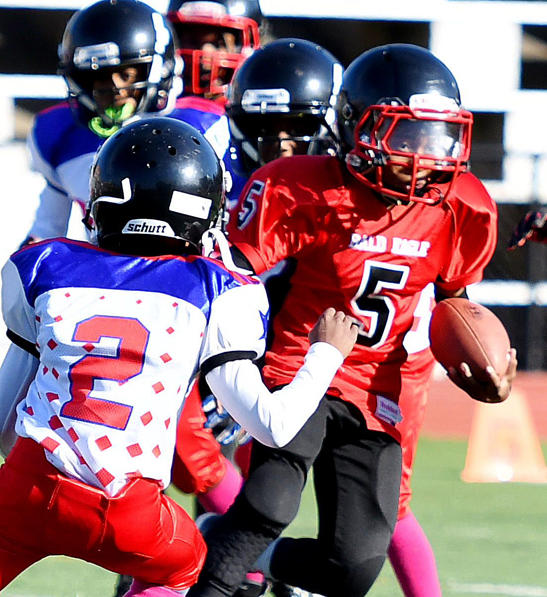 Rita Bright defenders converge on a Bald Eagle ball carrier during a DPR Youth Tackle Football League 10U game at Roosevelt High School Stadium in northwest D.C. on Saturday, Oct. 29. Bald Eagle defeated Rita Bright 25-21. /Photo by John E. De Freitas
