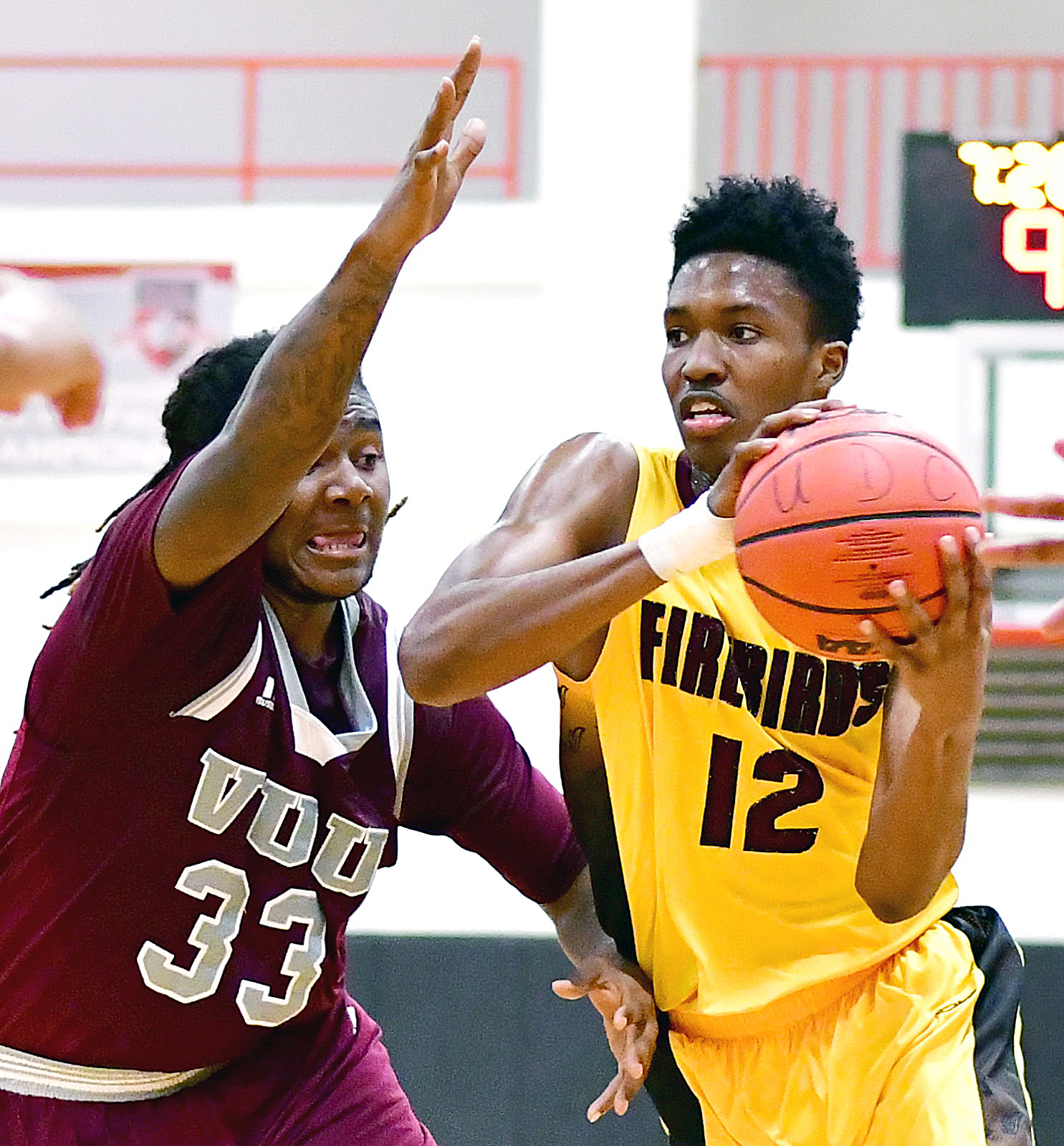 University of the District of Columbia guard Khalil Jackson drives against Virginia Union forward Tavon Mealy in the first half of Virginia Union's 71-69 win at UDC Gymnasium in Northwest on Wednesday, Nov. 30. /Photo by John E. De Freitas