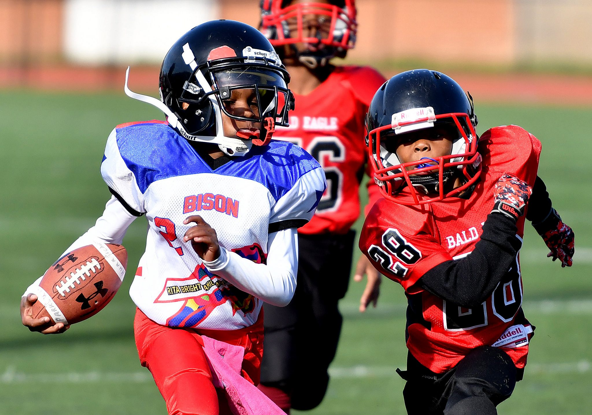 A Rita Bright player runs for a touchdown during a DPR Youth Tackle Football League 10U game at Roosevelt High School Stadium in northwest D.C. on Saturday, Oct. 29. Bald Eagle defeated Rita Bright 25-21. /Photo by John E. De Freitas