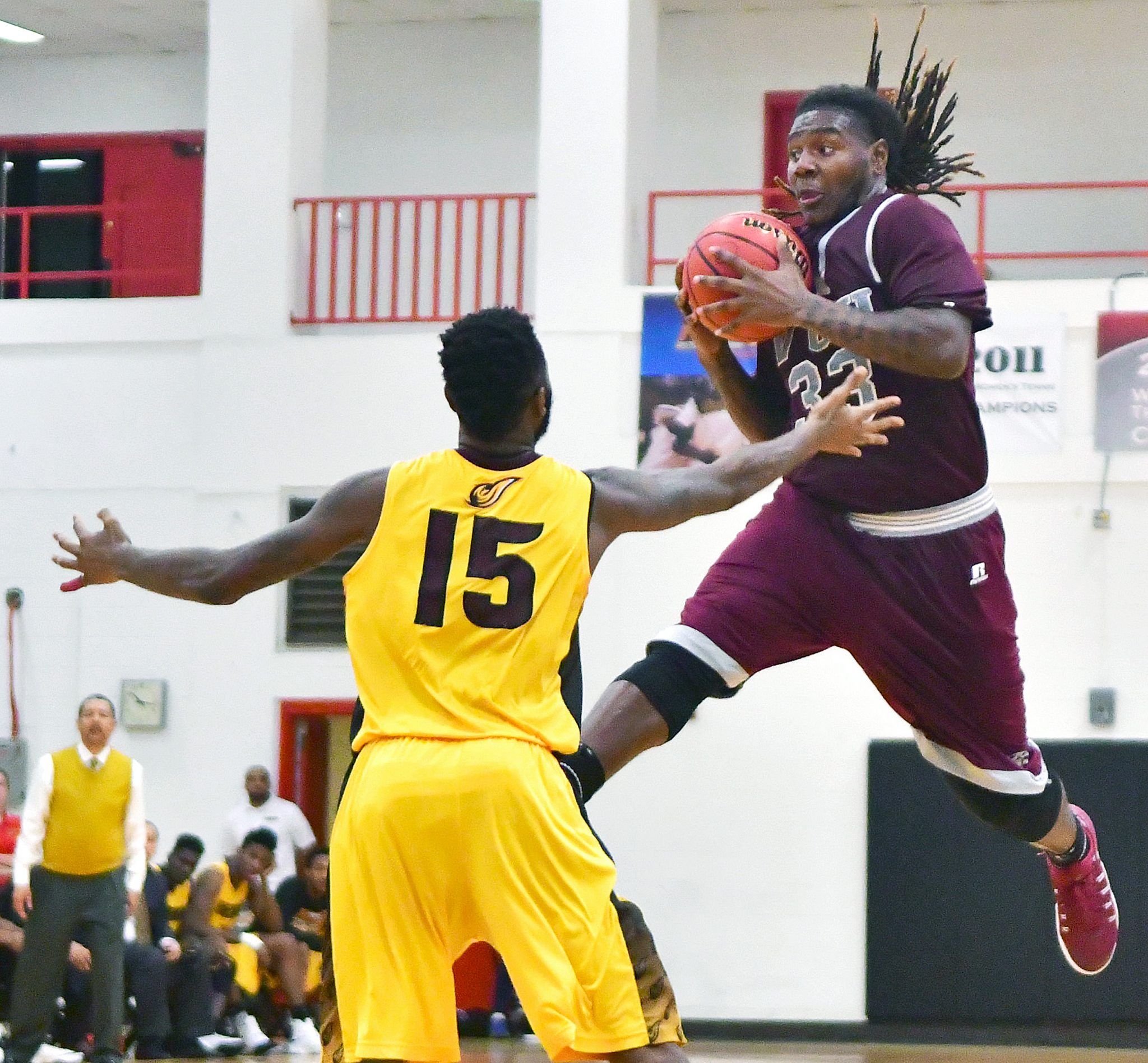 Virginia Union forward Tavon Mealy takes flight against University of the District of Columbia guard Joseph Nickerson in the second half of Virginia Union's 71-69 win at UDC Gymnasium in Northwest on Wednesday, Nov. 30. /Photo by John E. De Freitas