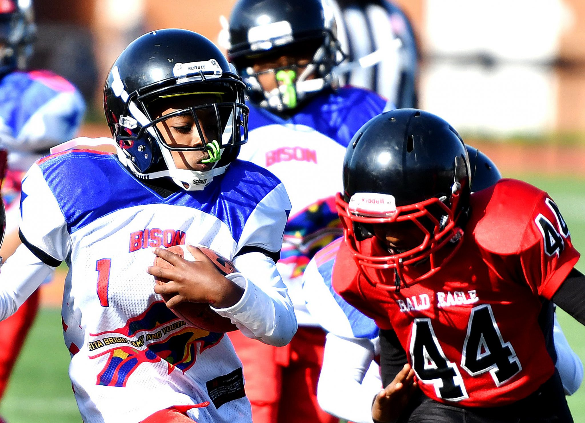 A Rita Bright ball carrier outruns a Bald Eagle defender during a DPR Youth Tackle Football League 10U game at Roosevelt High School Stadium in northwest D.C. on Saturday, Oct. 29. Bald Eagle defeated Rita Bright 25-21. /Photo by John E. De Freitas