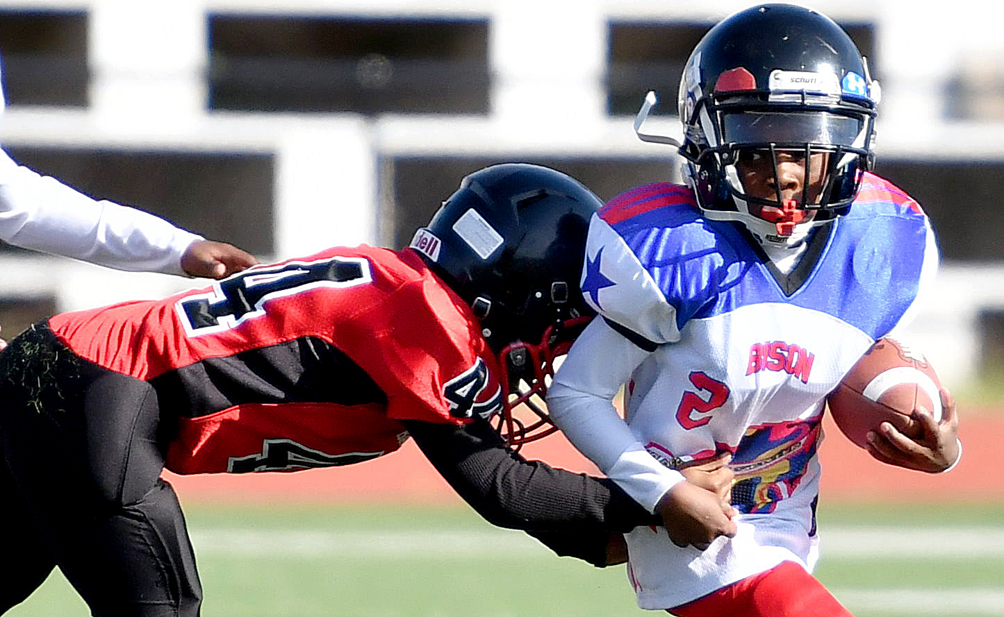 A Rita Bright player is tackled by a Bald Eagle defender during a DPR Youth Tackle Football League 10U game at Roosevelt High School Stadium in northwest D.C. on Saturday, Oct. 29. Bald Eagle defeated Rita Bright 25-21. /Photo by John E. De Freitas