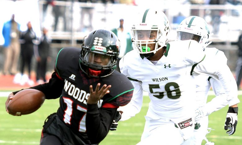 H.D. Woodson quarterback Tyron Robinson runs past Wilson High School defensive back Nicolas Allen for a first-quarter touchdown during Woodson's 22-20 win in the 47th annual DCIAA Turkey Bowl Football championship game at Eastern High School in northeast D.C on Thursday, Nov. 24. /Photo by John E. De Freitas