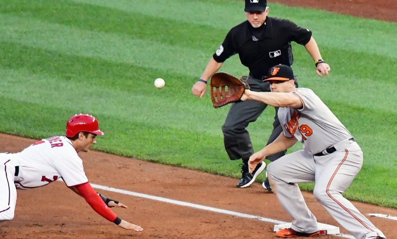 Washington Nationals center fielder Trea Turner slides back to first base as Baltimore Orioles first baseman Chris Davis awaits a pickoff attempt during the Orioles' 10-8 win over the Washington Nationals on Wednesday, Aug. 24 at Nationals Park in southeast D.C. /Photo by John E. De Freitas