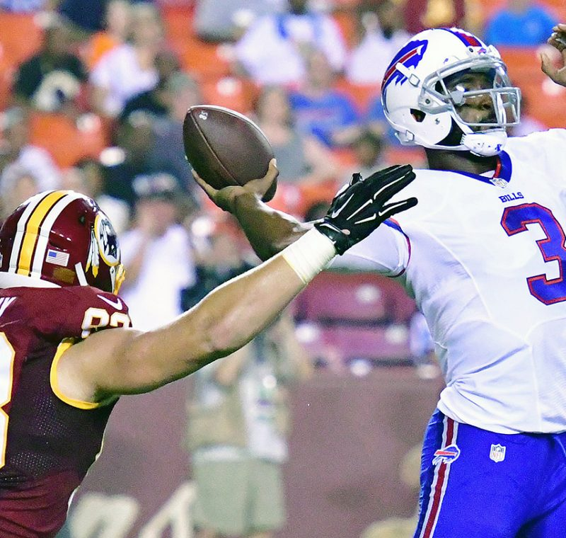 Buffalo Bills quarterback EJ Manuel attempts a pass as Washington Redskins defensive end Trent Murphy closes in during the Redskins' 21-16 preseason win at FedEx Field in Landover, Maryland, on Friday, Aug. 26. /Photo by John E. De Freitas