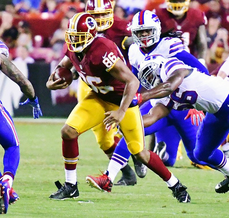 Washington Redskins tight end Jordan Reed attempts to evade defenders after a reception during the second quarter of the Redskins' 21-16 preseason win over the Buffalo Bills at FedEx Field in Landover, Maryland, on Friday, Aug. 26. /Photo by John E. De Freitas