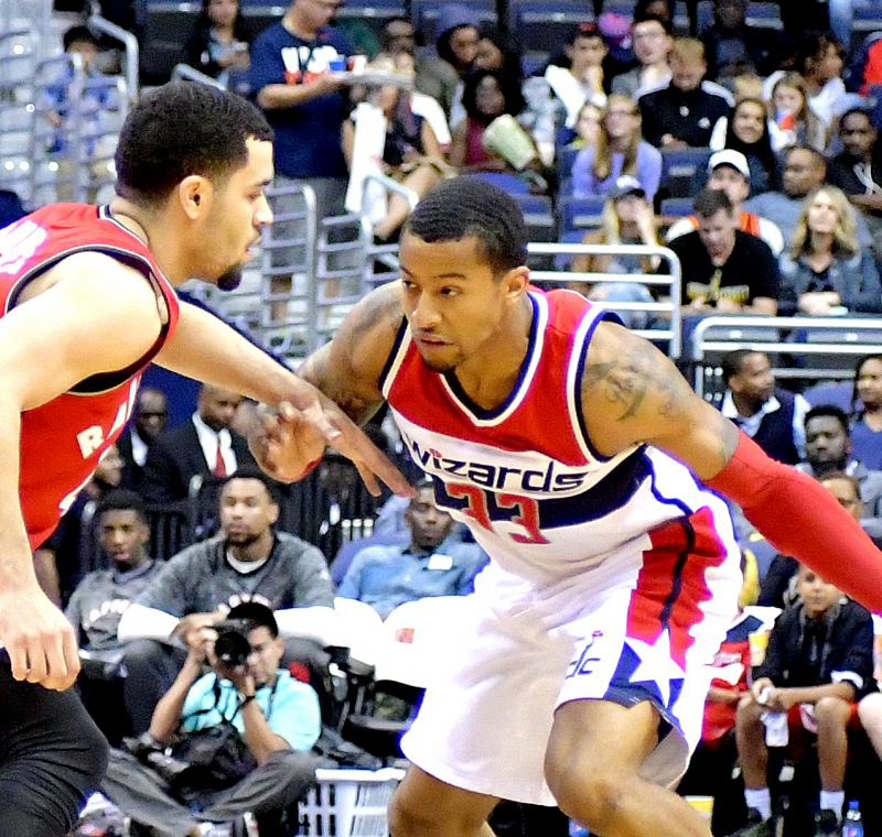 Washington Wizards guard Trey Burke faces off against Toronto Raptors guard Fred VanVleet during the Wizards' 119-82 home win in both teams' final preseason game on Friday, Oct. 21 at the Verizon Center in northwest D.C. /Photo by John E. De Freitas