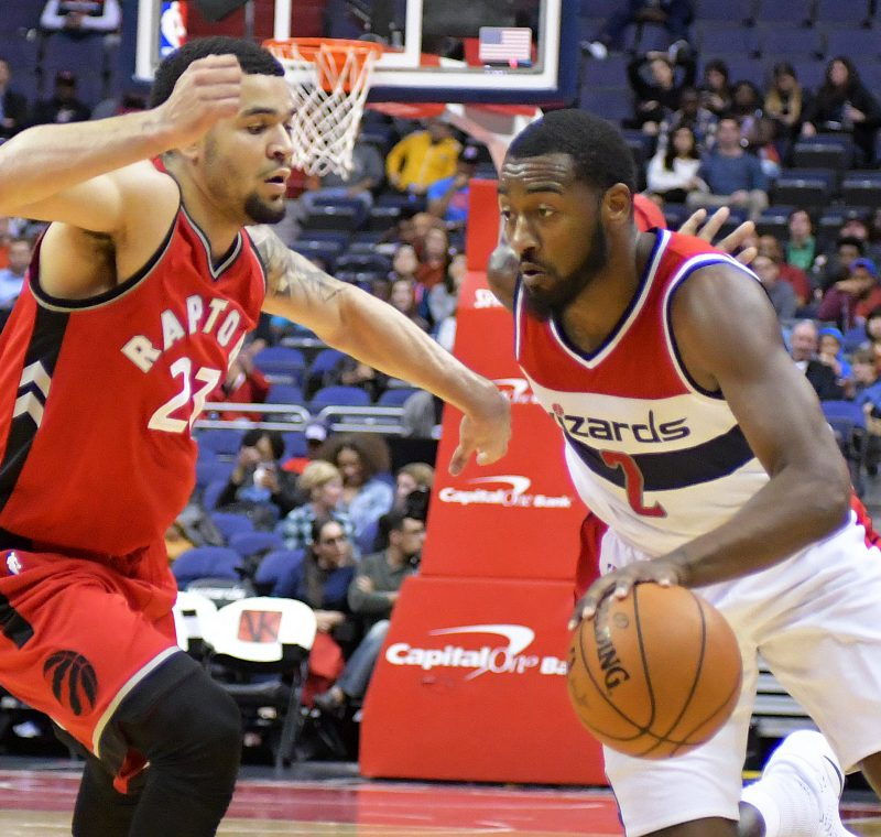 Washington Wizards guard John Wall drives past Toronto Raptors guard Fred VanVleet during the Wizards' 119-82 home win in both teams' final preseason game on Friday, Oct. 21 at the Verizon Center in northwest D.C. /Photo by John E. De Freitas