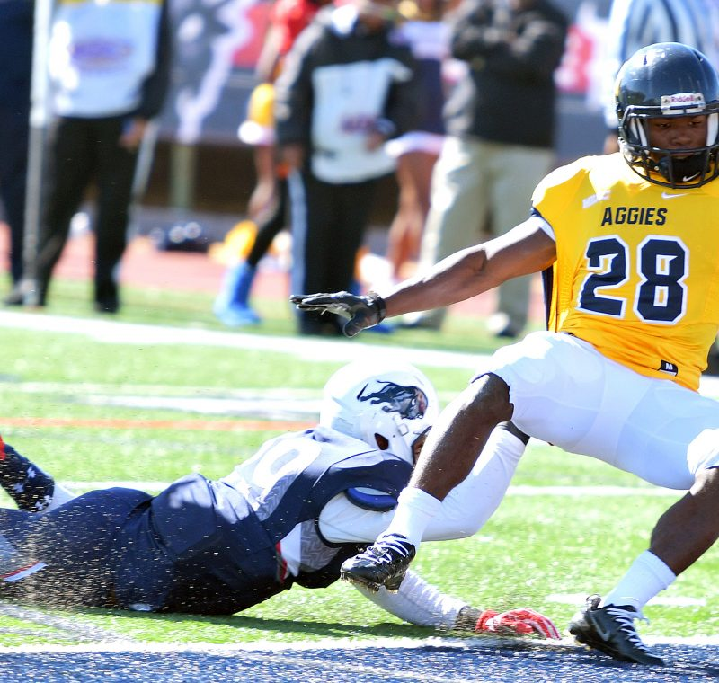 North Carolina A&T running back Tarik Cohen slips past a Howard Bison defender en route to a touchdown during the Aggies' 34-7 win in what was Howard's homecoming game on Saturday, Oct. 22 at William H. Greene Stadium in northwest D.C. /Photo by John E. De Freitas