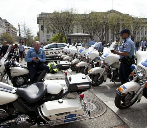 Members of the DC Metropolitan Police Department motorcycle branch park their motorcycles on Pennsylvania Avenue at the entrance to the road in front of the White House, in anticipation of a large inflated joint to be brought into the White House area. /Photo by Nancy Shia @nancy_shia