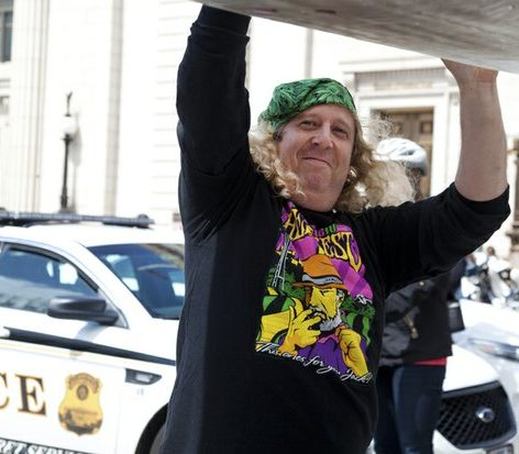 Capital Hemp co-owner Alan Amsterdam helps hold the giant joint at a protest near the White House Saturday, April 2, 2016. /Photo by Nancy Shia @nancy_shia