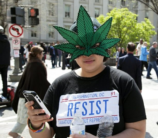 Sal Rivera, DC resident of Ward 3, shows her support for decriminalizing marijuana. /Photo by Nancy Shia @nancy_shia