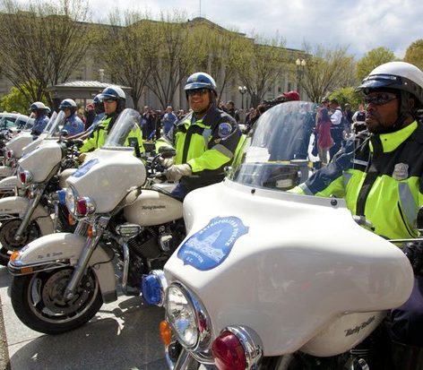 DC MPD motorcycle riders prepare to move their motorcycles off Pennsylvania Avenue in front of the Treasury Department, to leave the job of stopping the giant joint to the Uniformed Secret Service. /Photo by Nancy Shia @nancy_shia