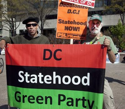 DC community activist Perry Redd and Howard University professor David Schwartzman proudly represent the DC Statehood Green Party at the rally for DC Statehood and protest against paying federal income taxes without Congressional representation, in Freedom Plaza Friday, April 15, 2016. /Photo by Nancy Shia @nancy_shia