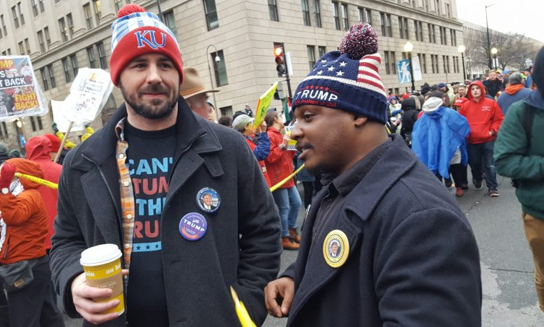 "Rob Robinson (right), a Donald Trump supporter from Colorado Springs, Colorado, came to the National Mall in Washington to witness the president-elect's inauguration, calling it ""another day in paradise."" (William J. Ford/The Washington Informer)"