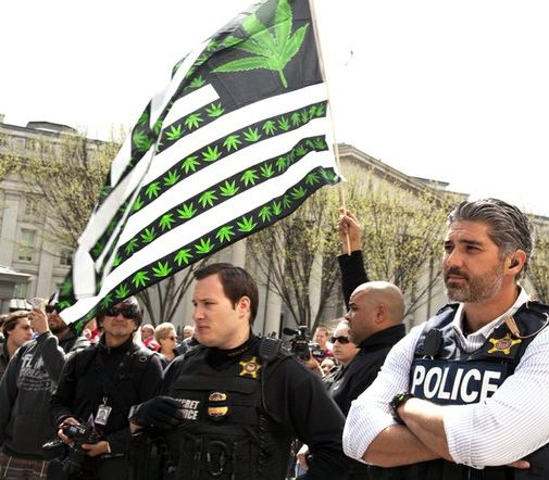 The marijuana flag flies freely behind Uniformed Secret Service people on Pennsylvania Avenue Northwest Saturday, April 2, 2016. /Photo by Nancy Shia @nancy_shia